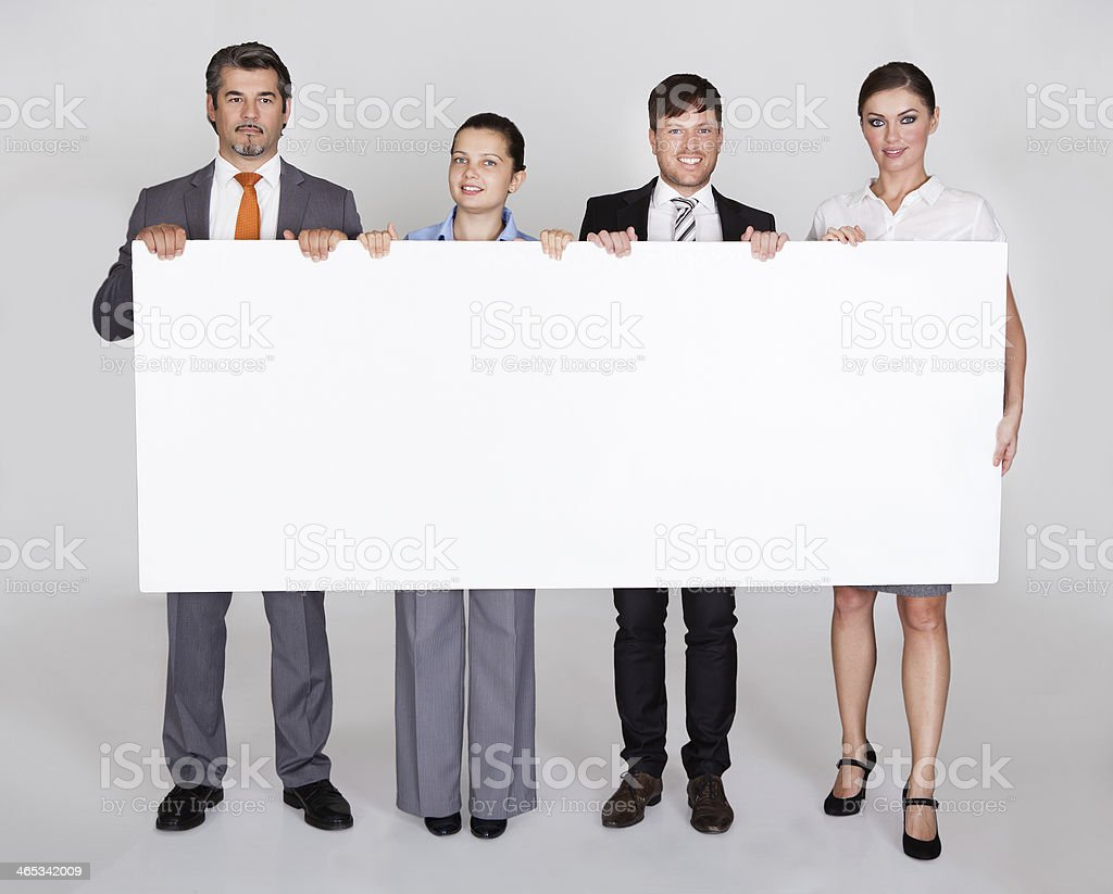 Businesspeople Holding Placard stock photo