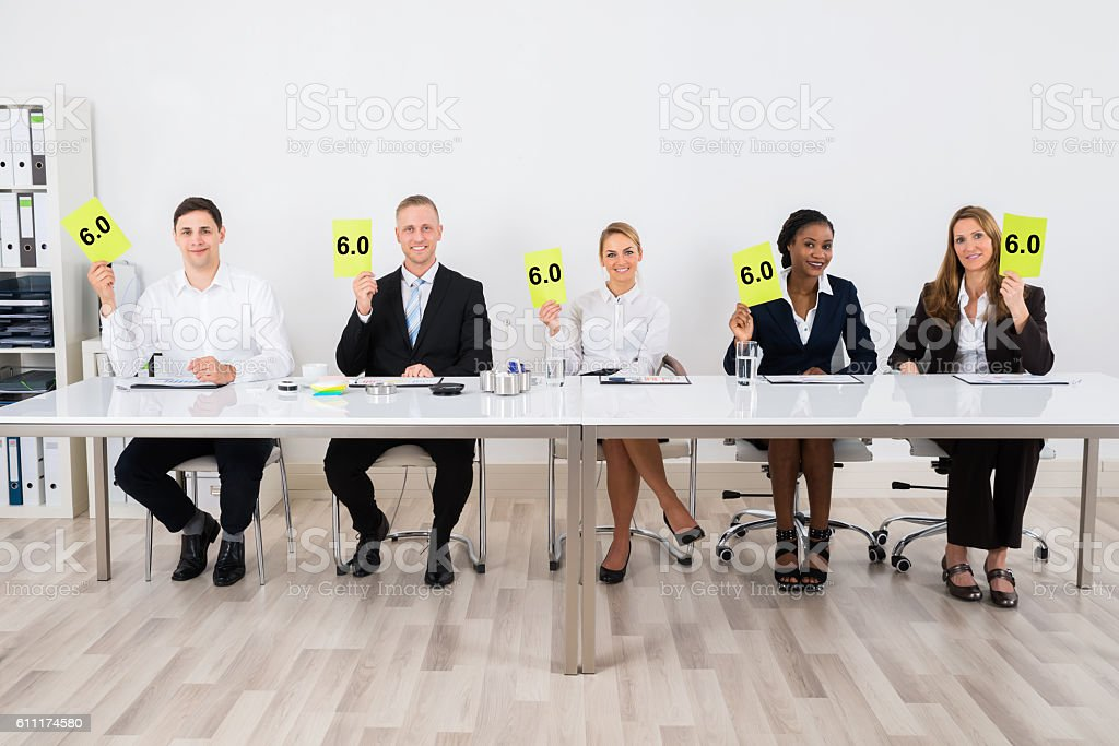 Businesspeople Holding Voting Paper stock photo
