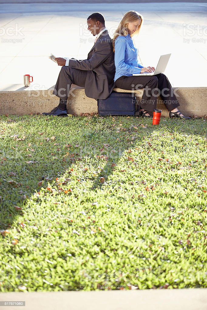 Businesspeople in a park stock photo