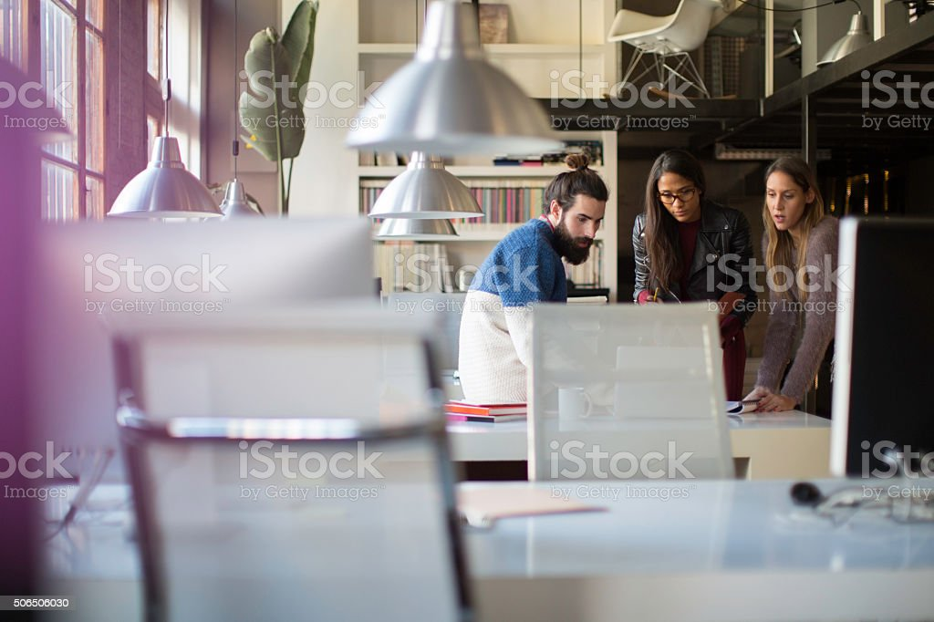 Businesspeople in an informal meeting in their office. stock photo