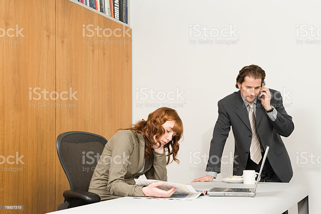 Businesspeople in an office stock photo