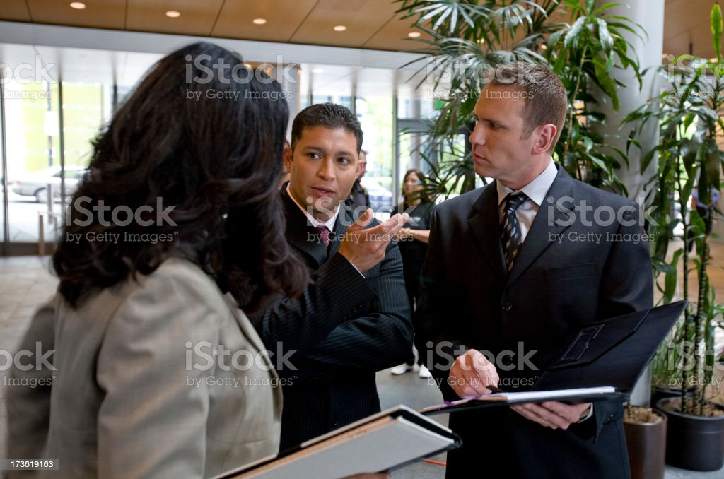 Businesspeople in deep discussion stock photo