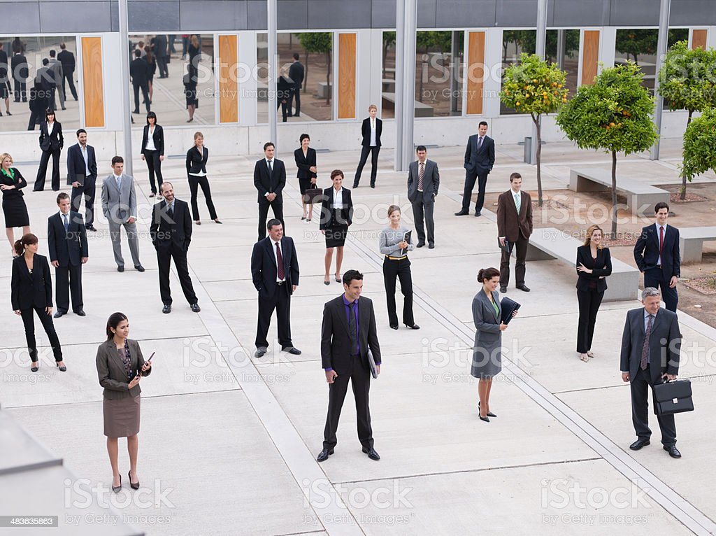 Businesspeople in modern office courtyard stock photo