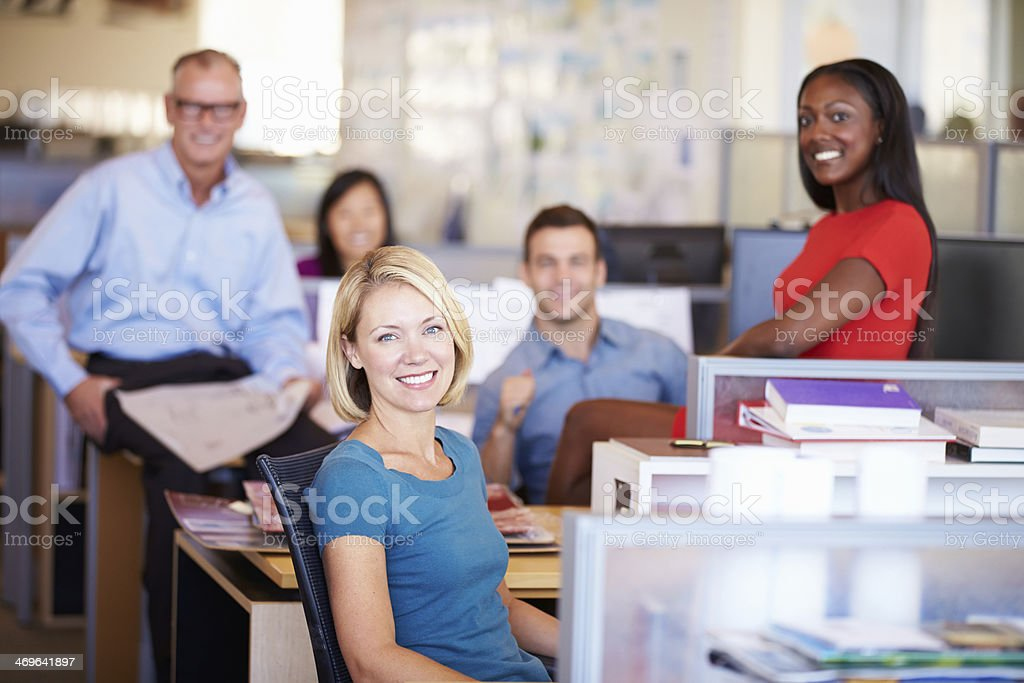 Businesspeople in modern office smiling at camera stock photo