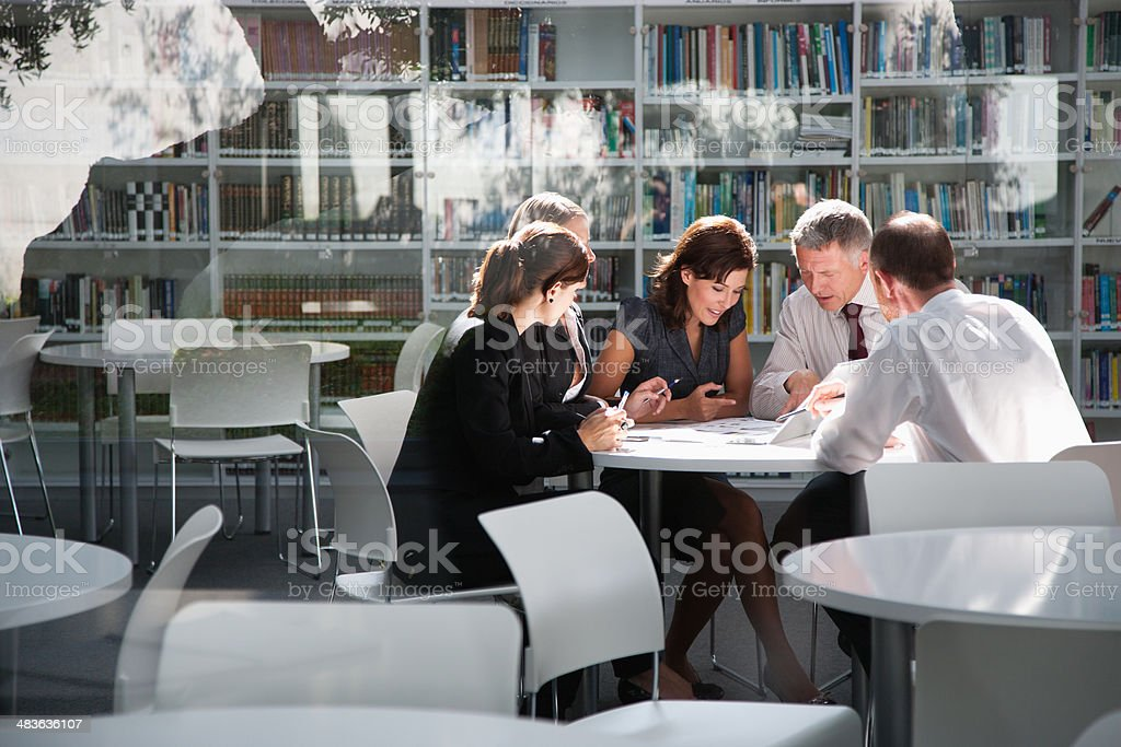 Businesspeople in office meeting stock photo