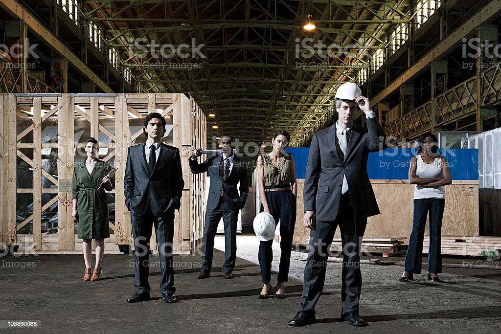 Businesspeople in warehouse stock photo