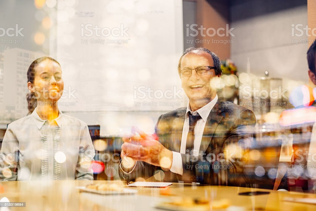 Businesspeople laughing in the office stock photo