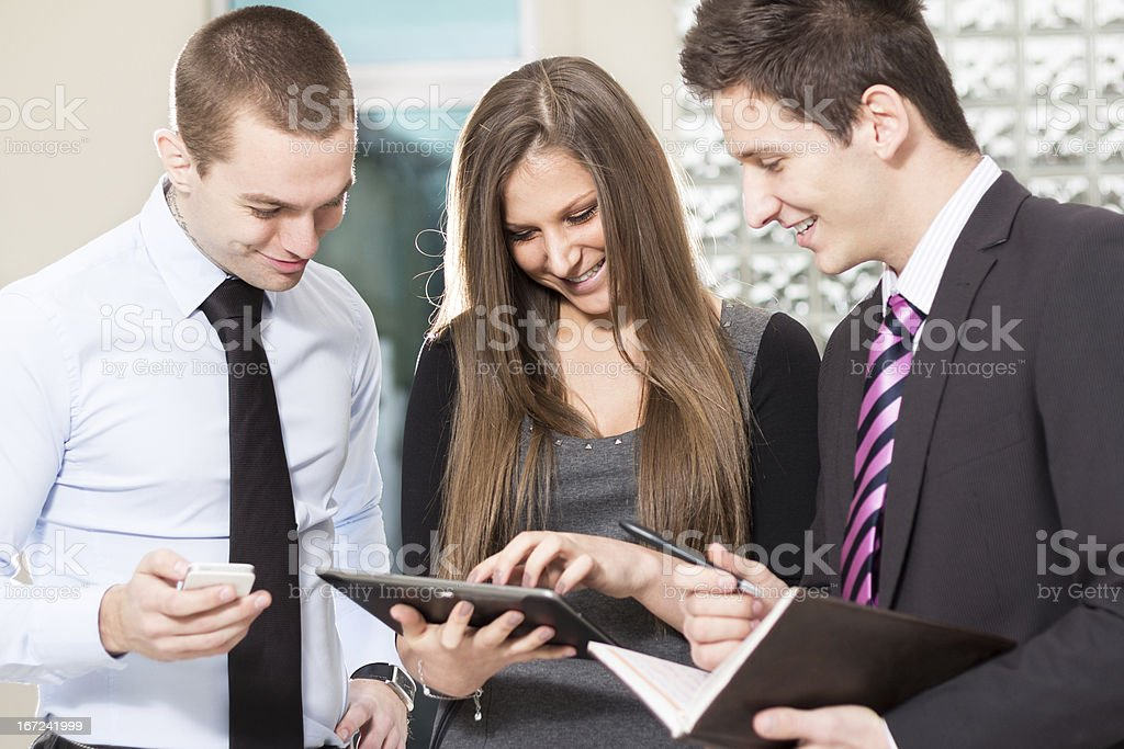 Businesspeople Looking a Computer Tablet stock photo
