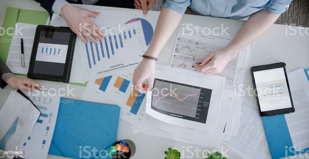 Businesspeople looking charts stock photo