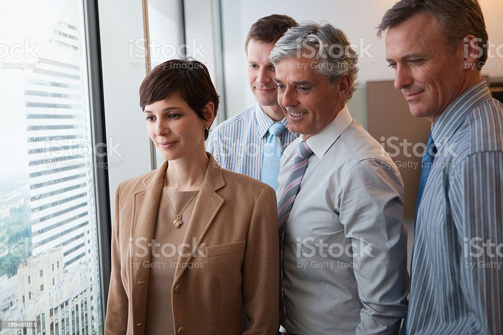 Businesspeople looking out window royalty-free stock photo