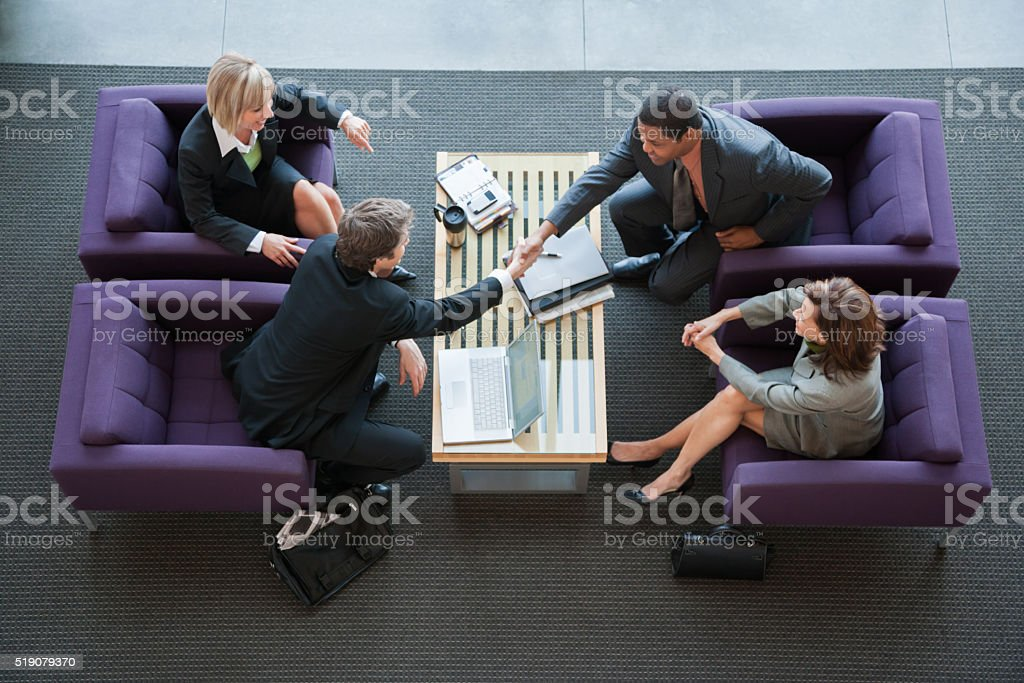 Businesspeople making introductions stock photo