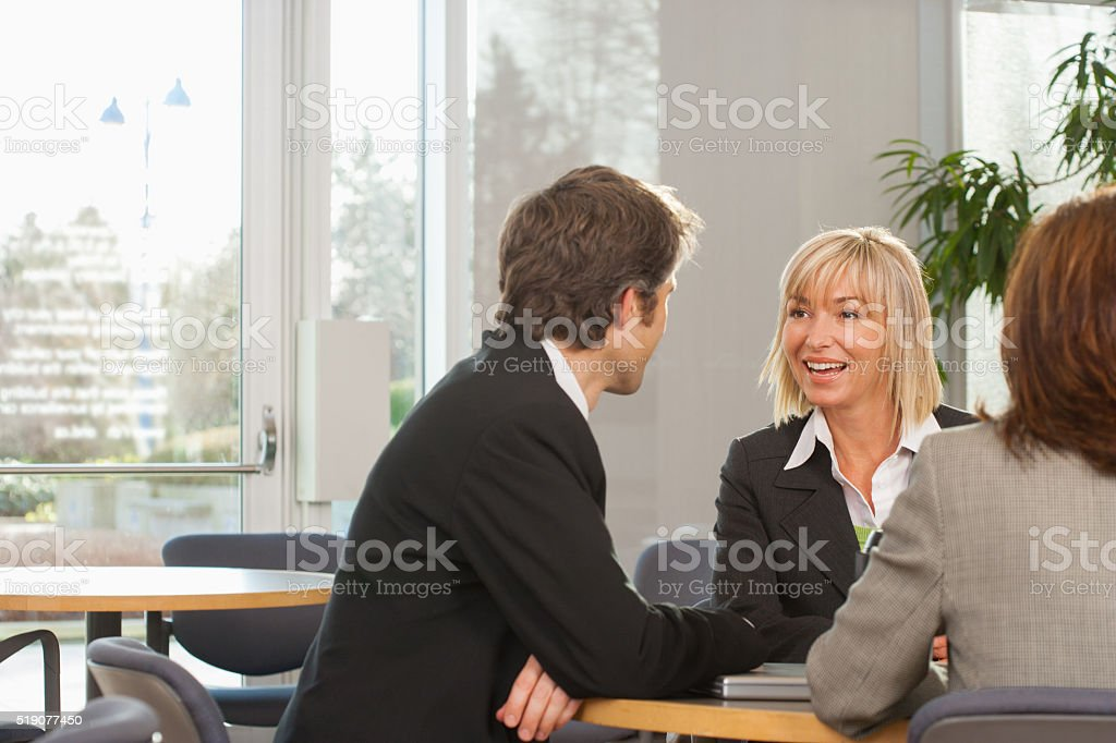 Businesspeople meeting in cafeteria stock photo