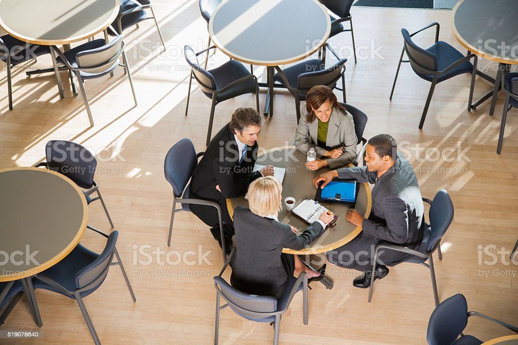 Businesspeople meeting over coffee stock photo