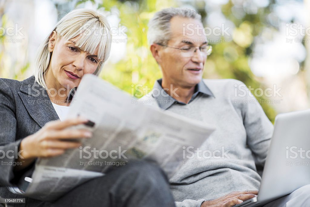 Businesspeople on a break in park. stock photo