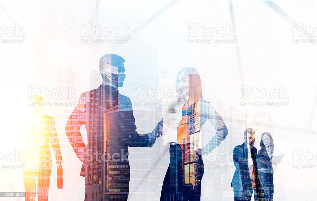 Businesspeople on cityscape stock photo