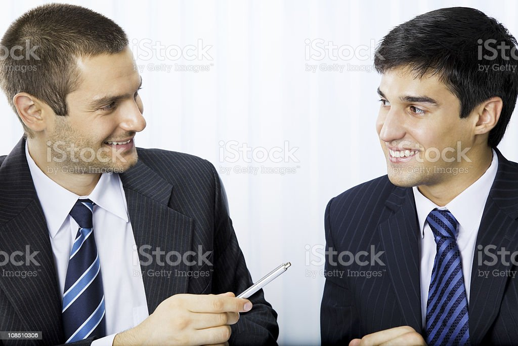 Businesspeople or client and businessman, giving pen for signing document royalty-free stock photo