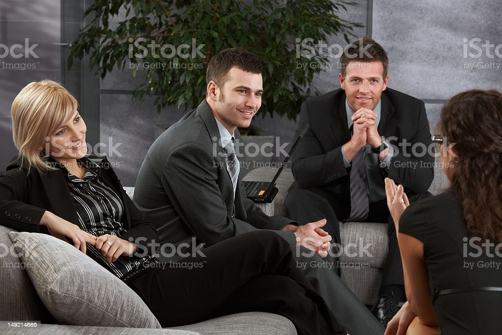 Businesspeople resting on sofa royalty-free stock photo