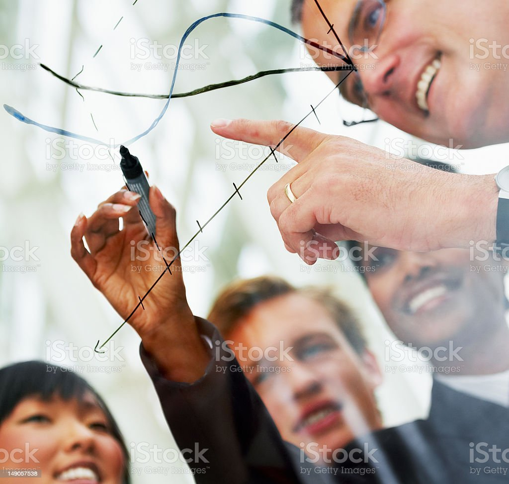 Businesspeople reviewing their performance with a graph royalty-free stock photo