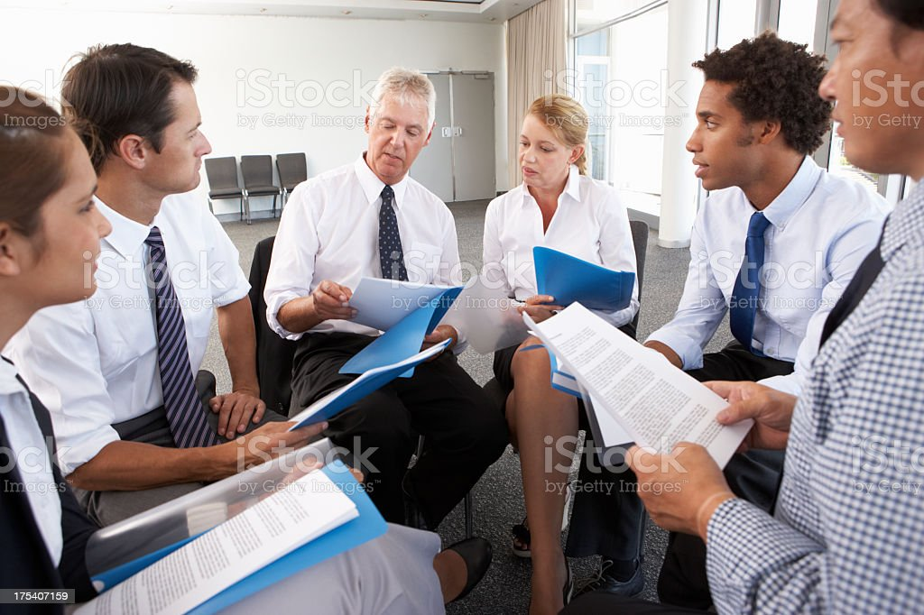 Businesspeople Seated In Circle At Company Seminar royalty-free stock photo