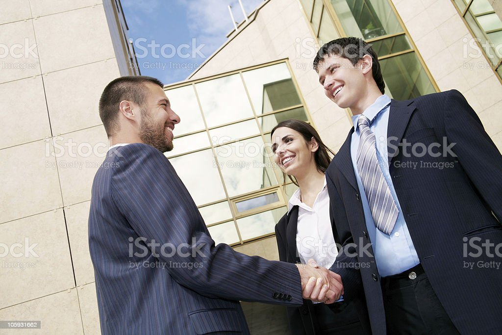 businesspeople shake hands royalty-free stock photo
