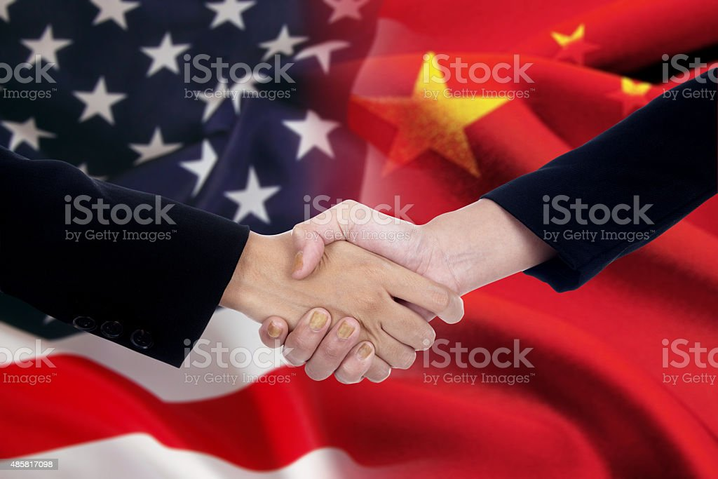 Businesspeople shaking hands after negotiation stock photo