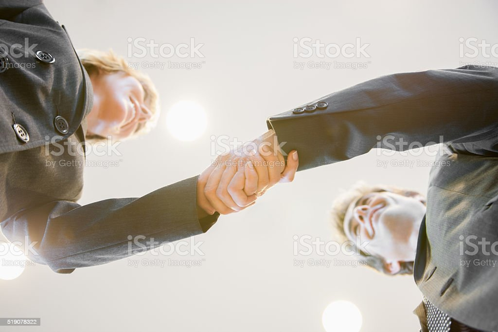 Businesspeople shaking hands stock photo