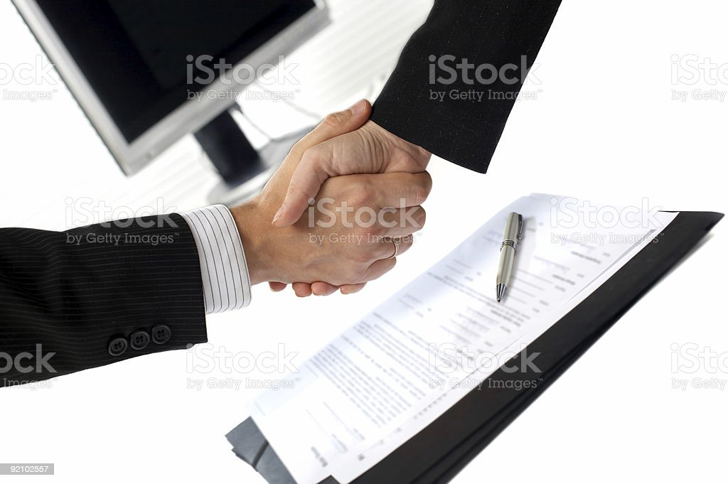 Businesspeople shaking hands royalty-free stock photo