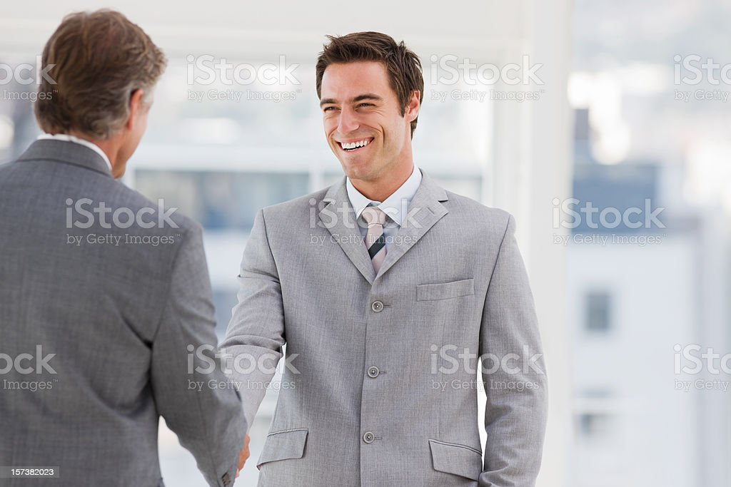 Businesspeople shaking hands together royalty-free stock photo