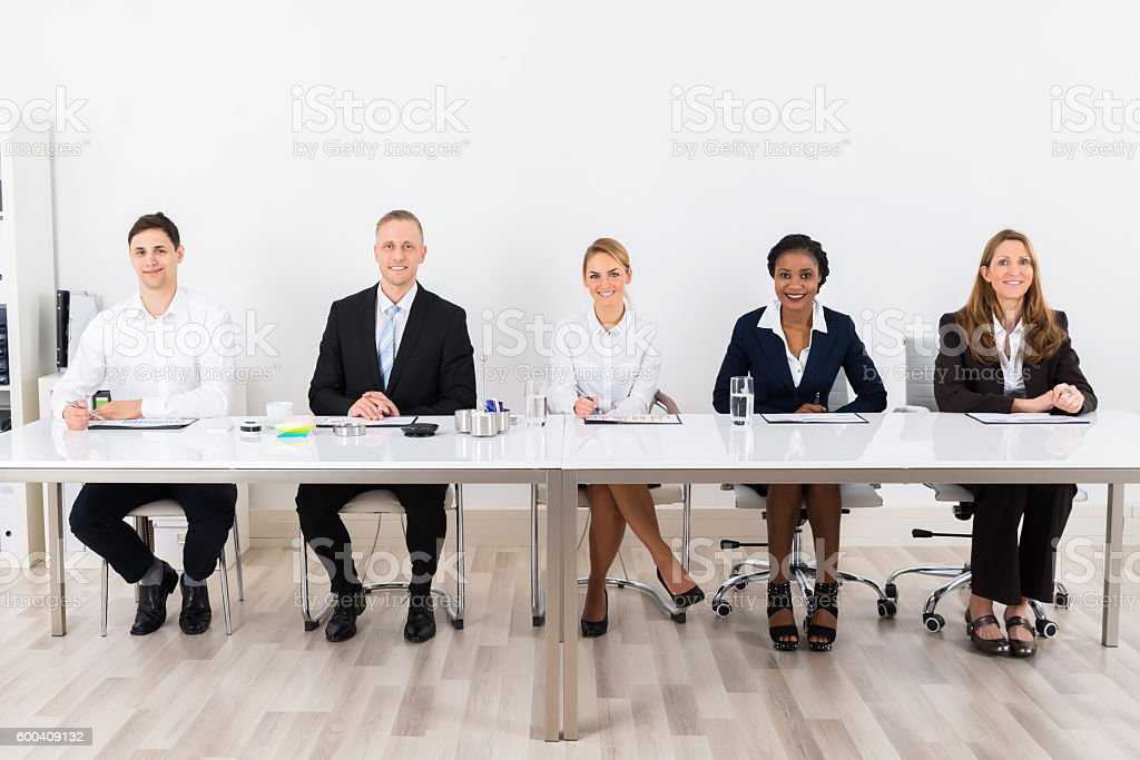 Businesspeople Sitting At Conference stock photo
