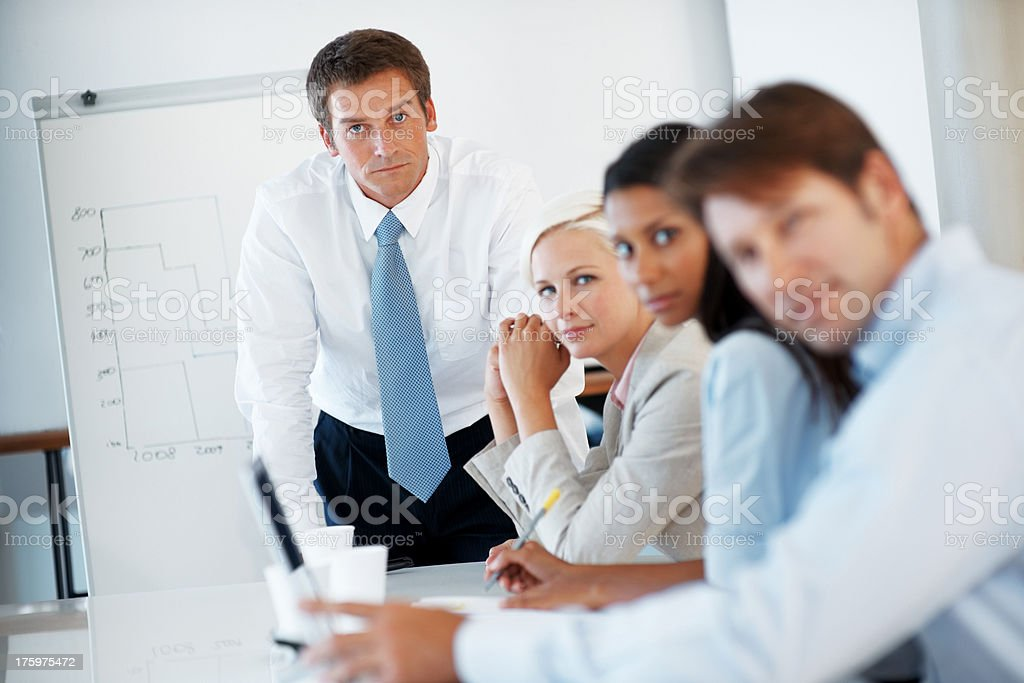 Businesspeople sitting together during a presentation stock photo