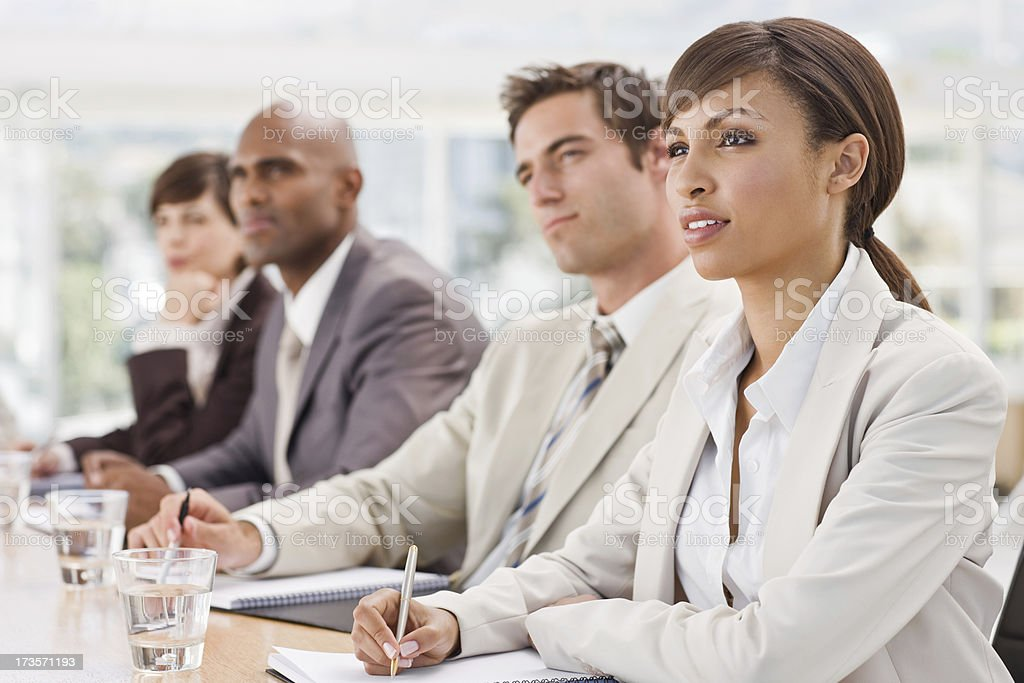 Businesspeople sitting together in meeting royalty-free stock photo