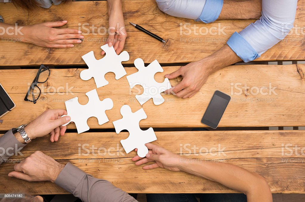 Businesspeople solving problem stock photo