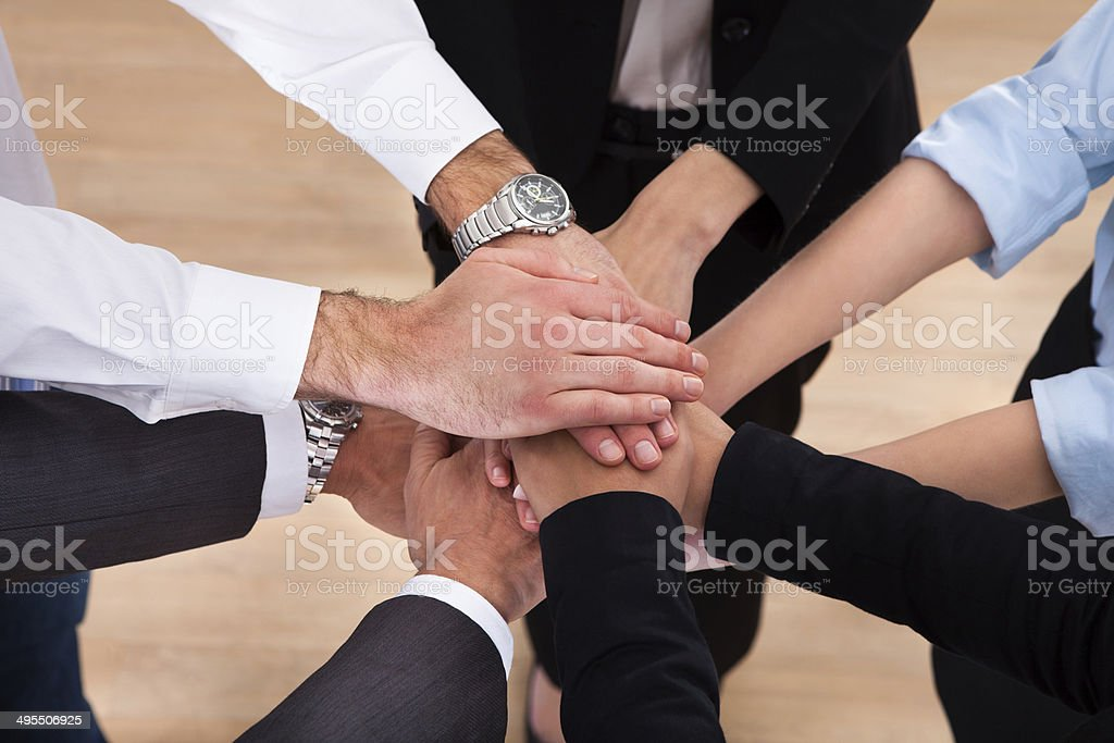 Businesspeople Stacking Their Hands stock photo