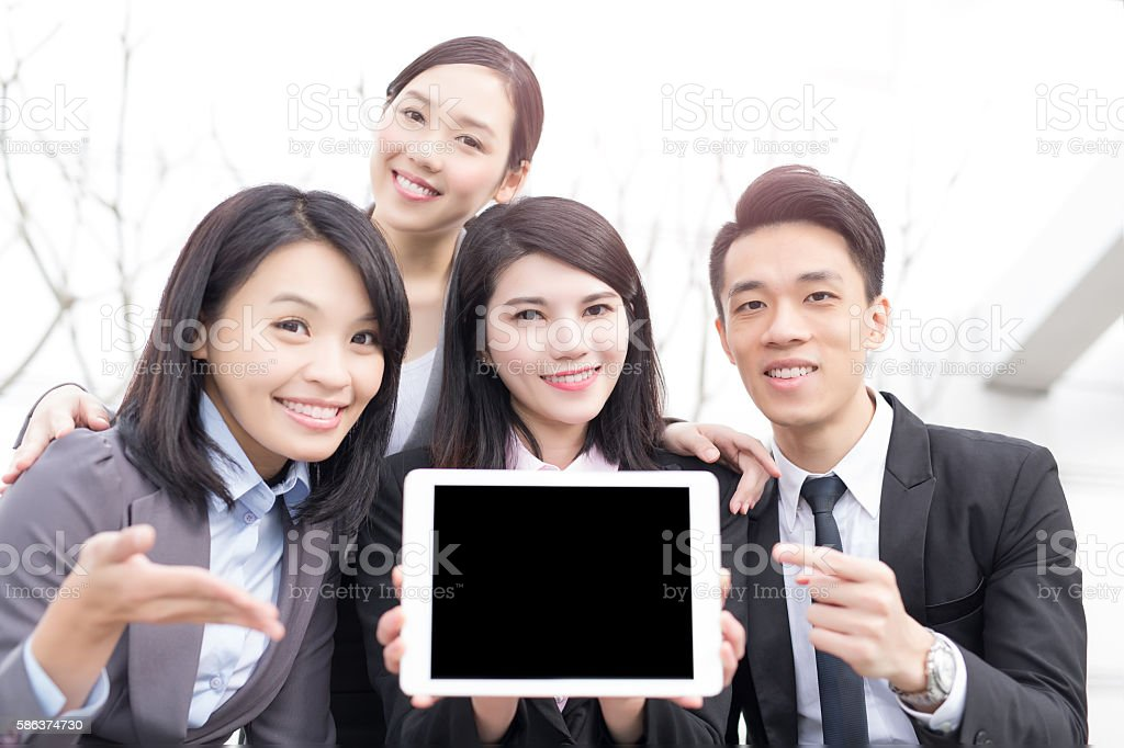 businesspeople take tablet show something stock photo