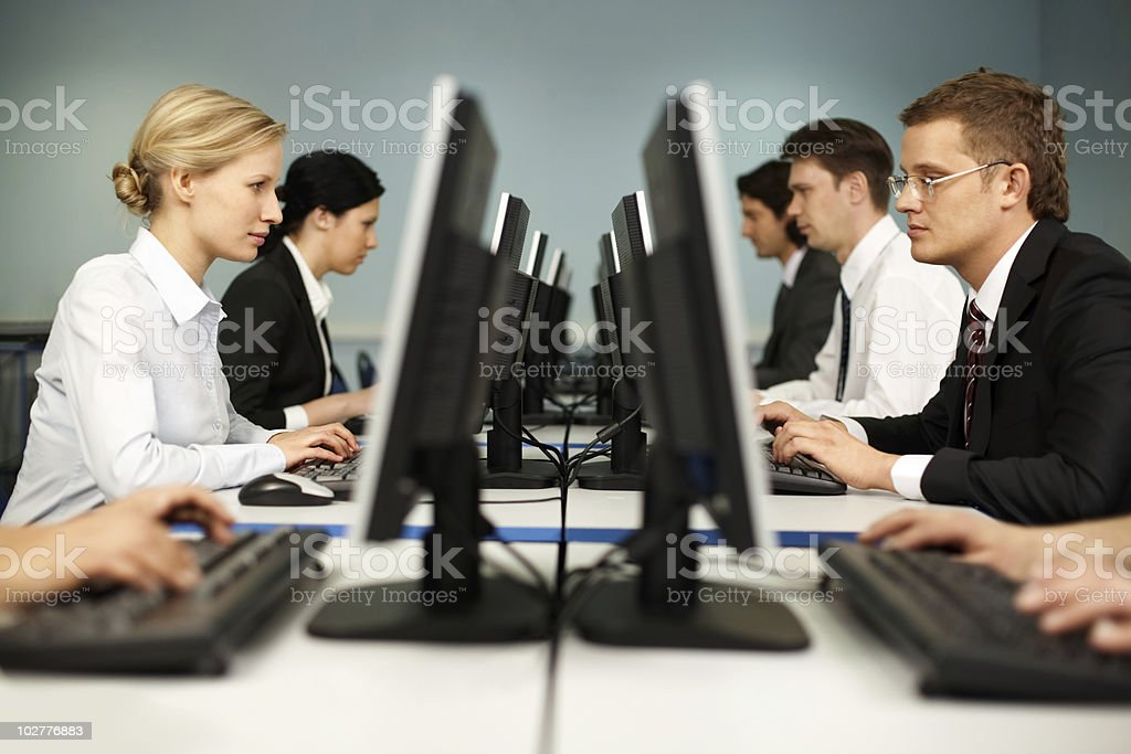 Businesspeople taking a computer class royalty-free stock photo