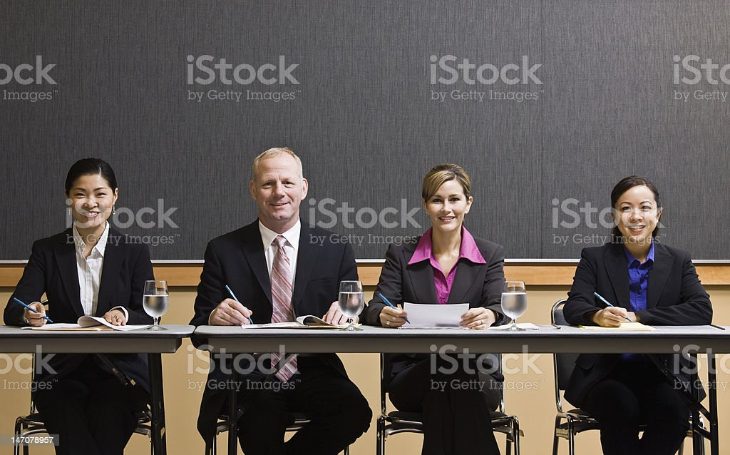 Businesspeople Taking Notes at a Meeting royalty-free stock photo