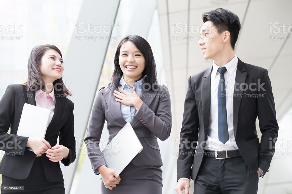 businesspeople talk in office stock photo