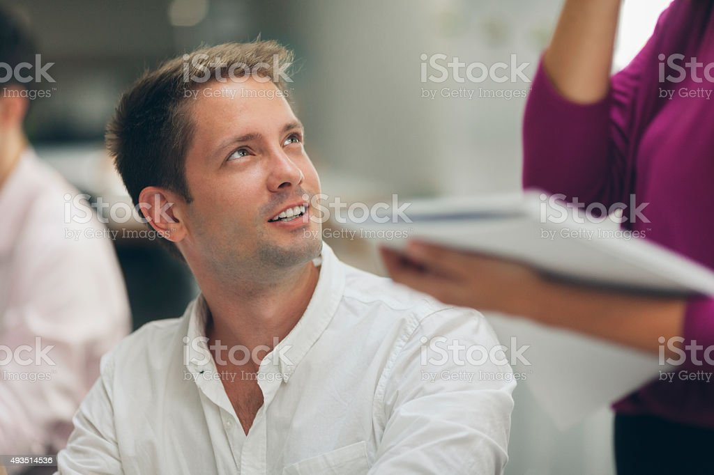 Businesspeople talking in office. stock photo