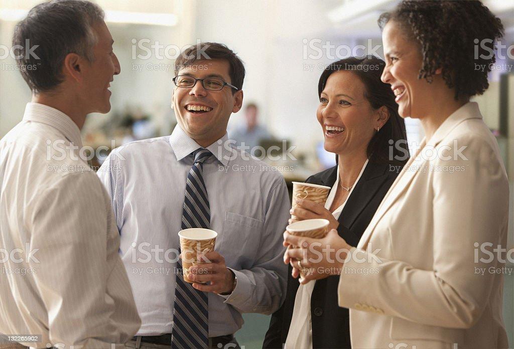 businesspeople talking over coffee break royalty-free stock photo
