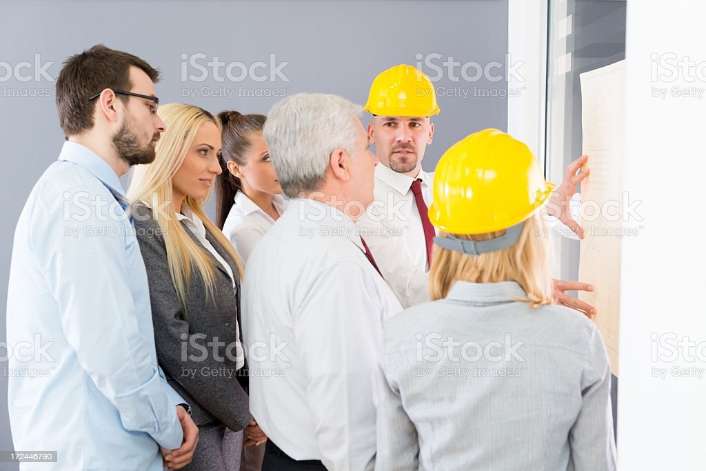 Businesspeople talking with contractors royalty-free stock photo
