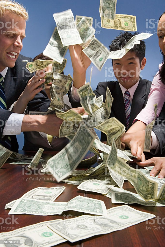 Businesspeople throwing money stock photo