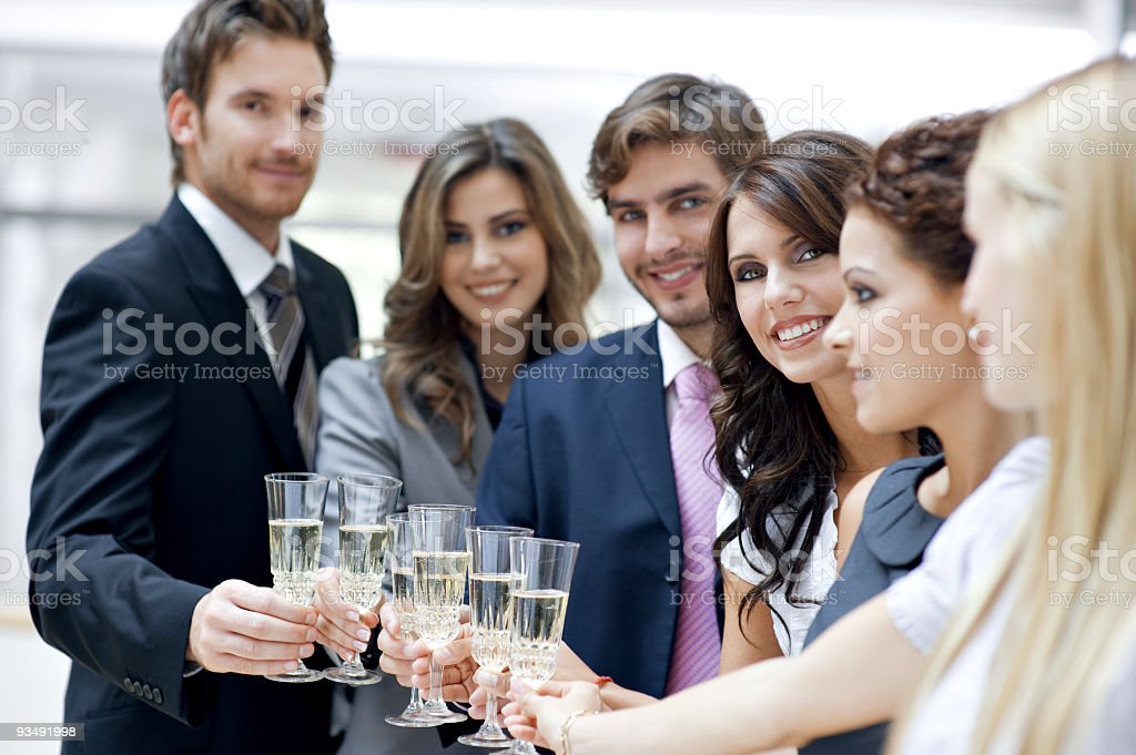 Businesspeople toasting flutes of champagne royalty-free stock photo