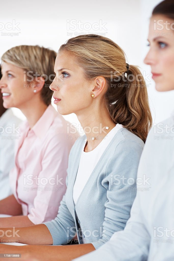 Businesspeople together sitting in a row attending meeting stock photo