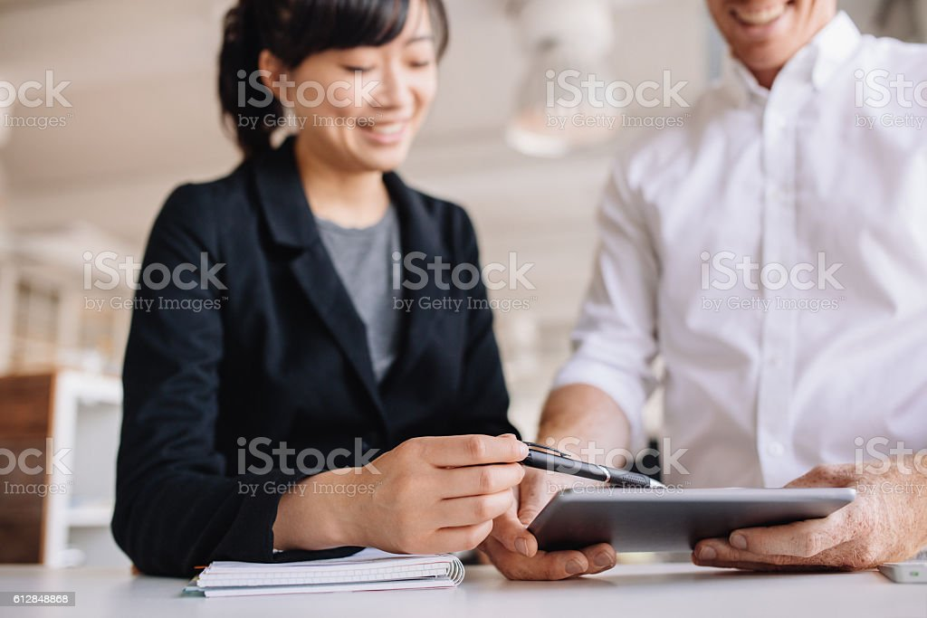 Businesspeople using touchscreen computer in office stock photo