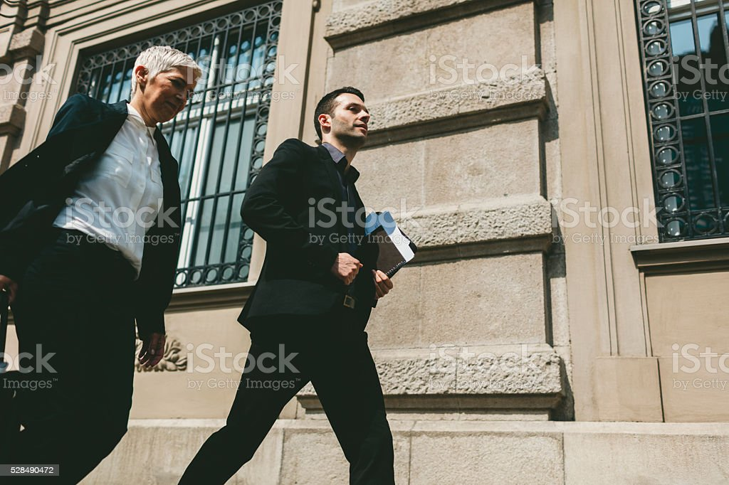 Businesspeople Walking In City. stock photo