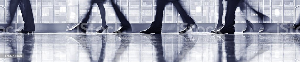 Businesspeople walking in lobby, low section royalty-free stock photo