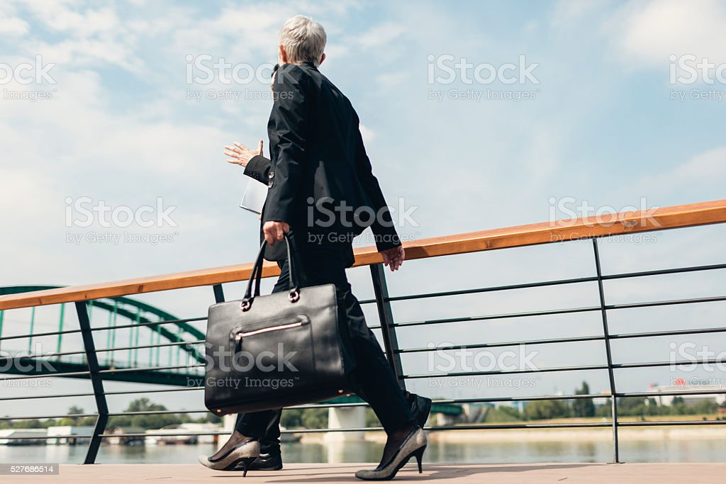 Businesspeople Walking On The Waterfront stock photo