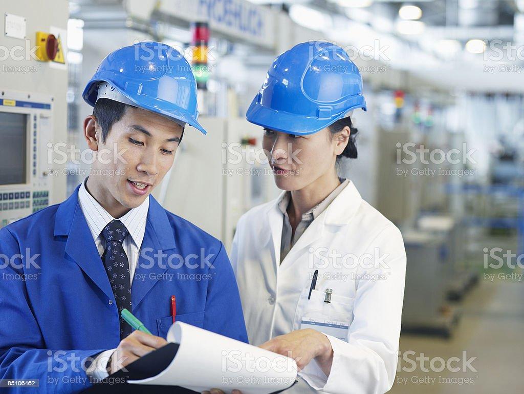 Businesspeople wearing hard-hats stock photo