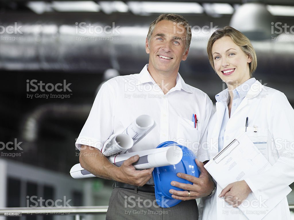 Businesspeople with blueprints royalty-free stock photo