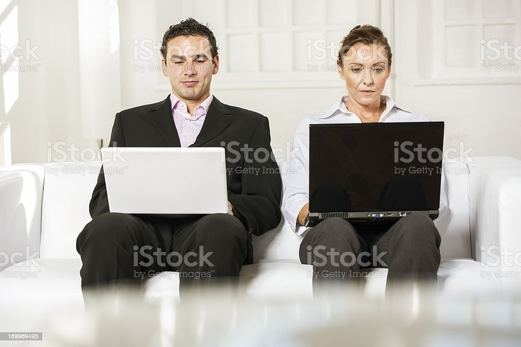 Businesspeople with laptops royalty-free stock photo